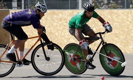 Two players jostle for possession at the World Hardcourt Bike Polo Championship in Geneva